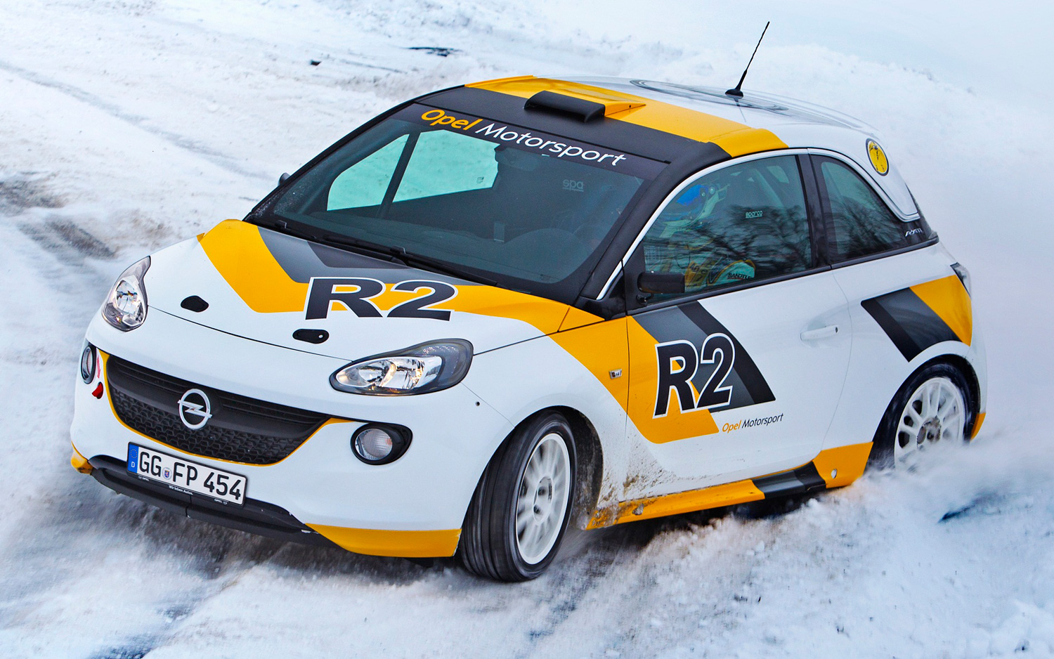 FWD Opel rally car, notice how the back end is sliding but the frnt wheels clawing for traction. Photo: mototrend